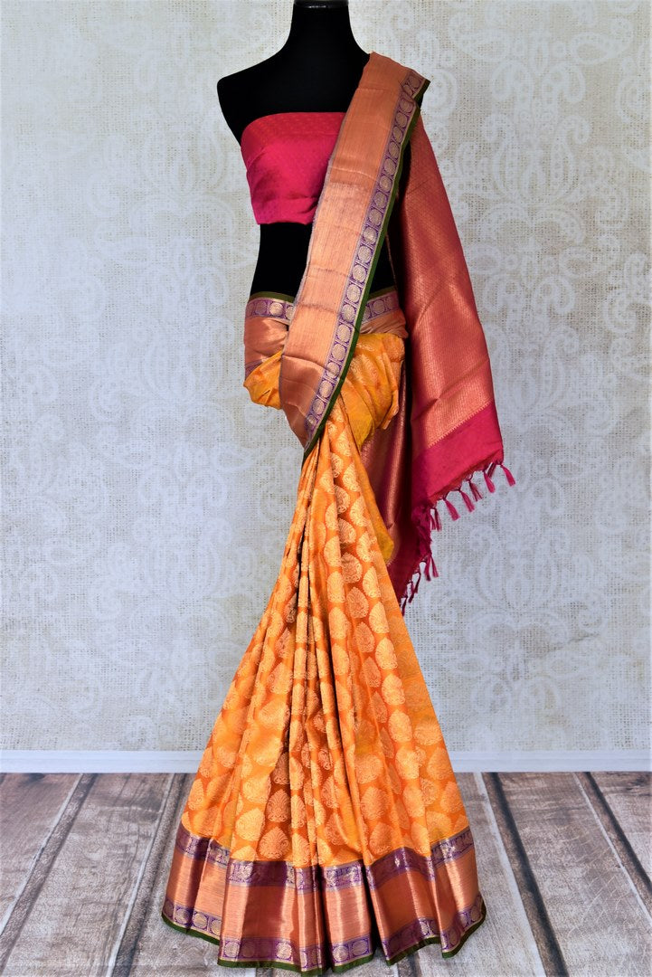 Shop beautiful orange Kanjivaram saree online in USA with zari buta and zari border. Look beautiful on weddings with exquisite Kanjivaram sarees from Pure Elegance Indian fashion store in USA. Get spoiled for choices with a myriad of pure silk sarees, Kanjeevaram saris available online.-full view