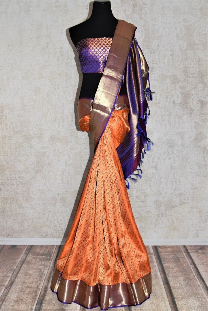 Buy orange heavy Kanjivaram saree online in USA with blue zari border. Look beautiful on weddings with exquisite Kanjivaram sarees from Pure Elegance Indian fashion store in USA. Get spoiled for choices with a myriad of pure silk sarees, Kanjeevaram saris available online.-full view