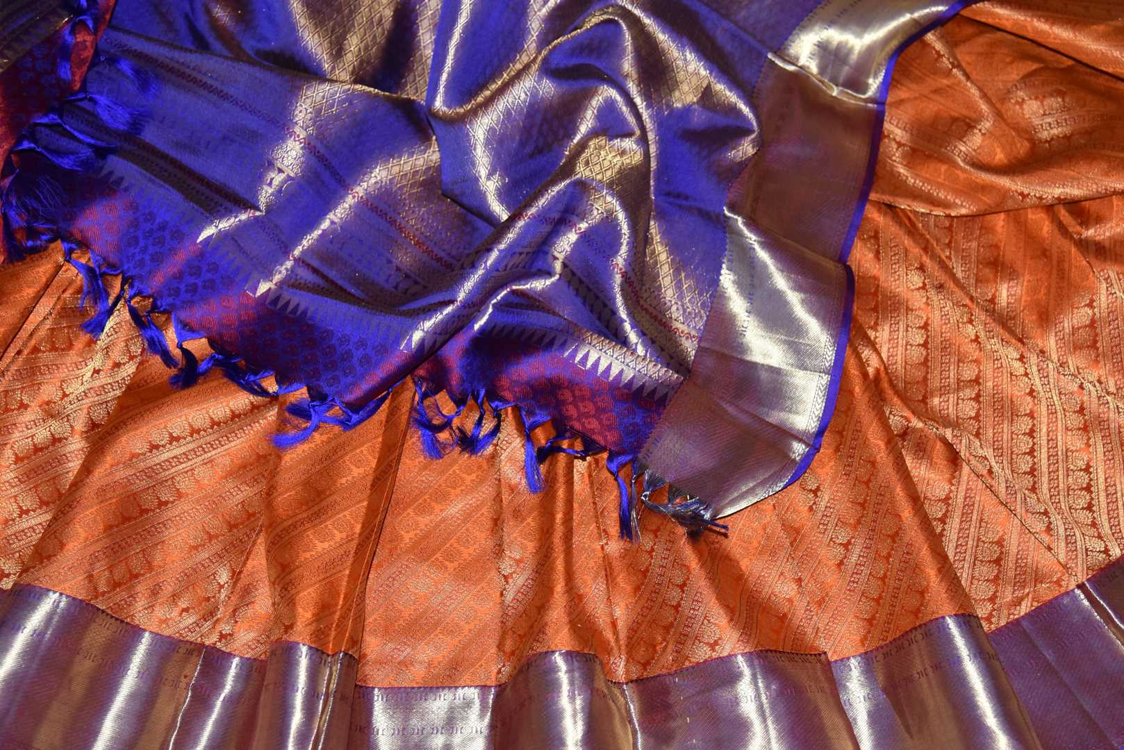 Buy orange heavy Kanjivaram saree online in USA with blue zari border. Look beautiful on weddings with exquisite Kanjivaram sarees from Pure Elegance Indian fashion store in USA. Get spoiled for choices with a myriad of pure silk sarees, Kanjeevaram saris available online.-details