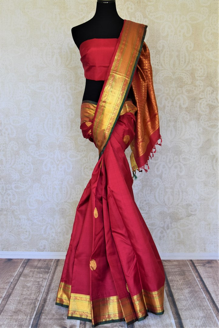 Shop beautiful blood red Kanjeevaram sari with golden zari border online in USA. Add spark to your festive style with beautiful Kanchipuram silk sarees in USA from Pure Elegance Indian fashion store.-full view