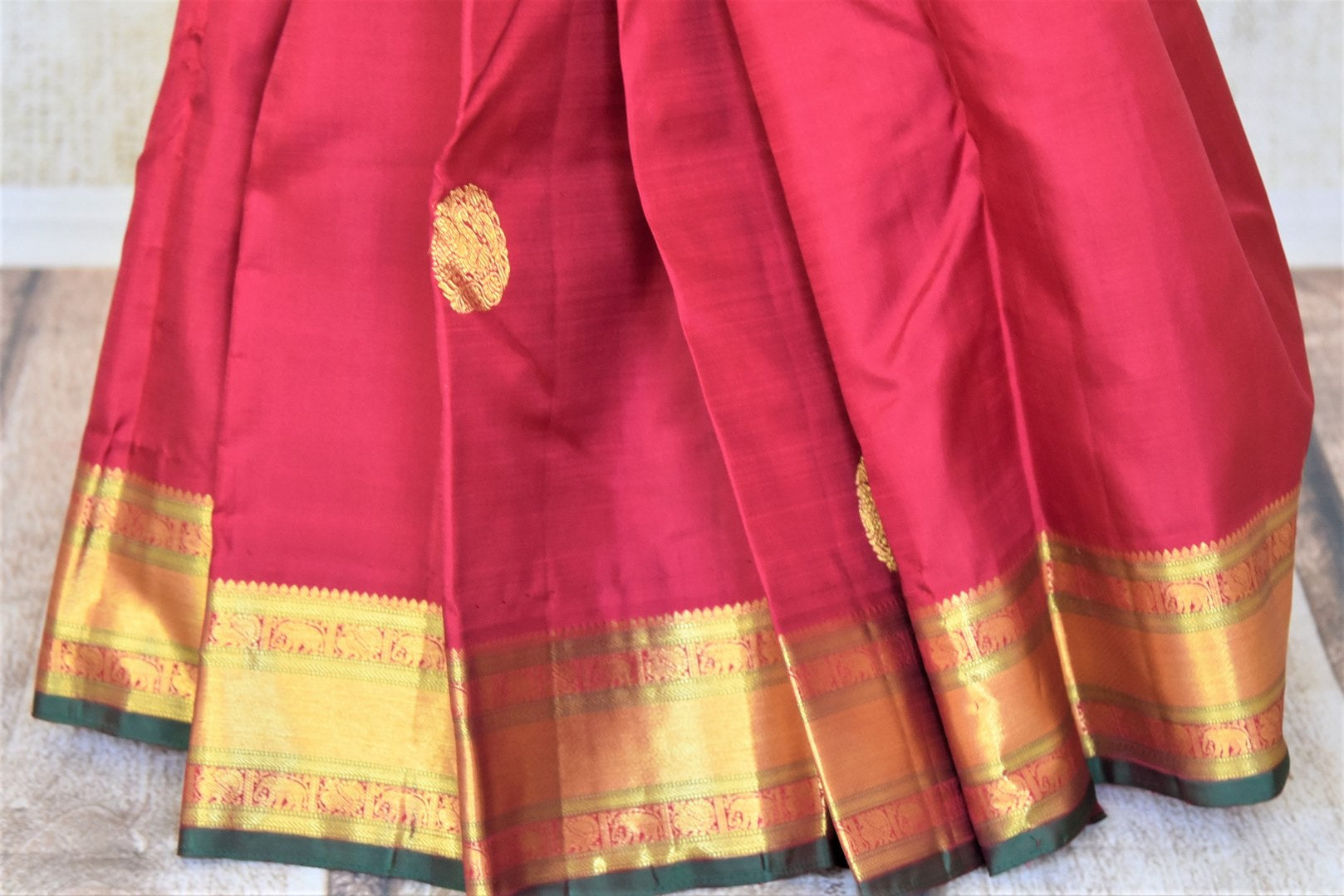 Shop beautiful blood red Kanjeevaram sari with golden zari border online in USA. Add spark to your festive style with beautiful Kanchipuram silk sarees in USA from Pure Elegance Indian fashion store.-pleats