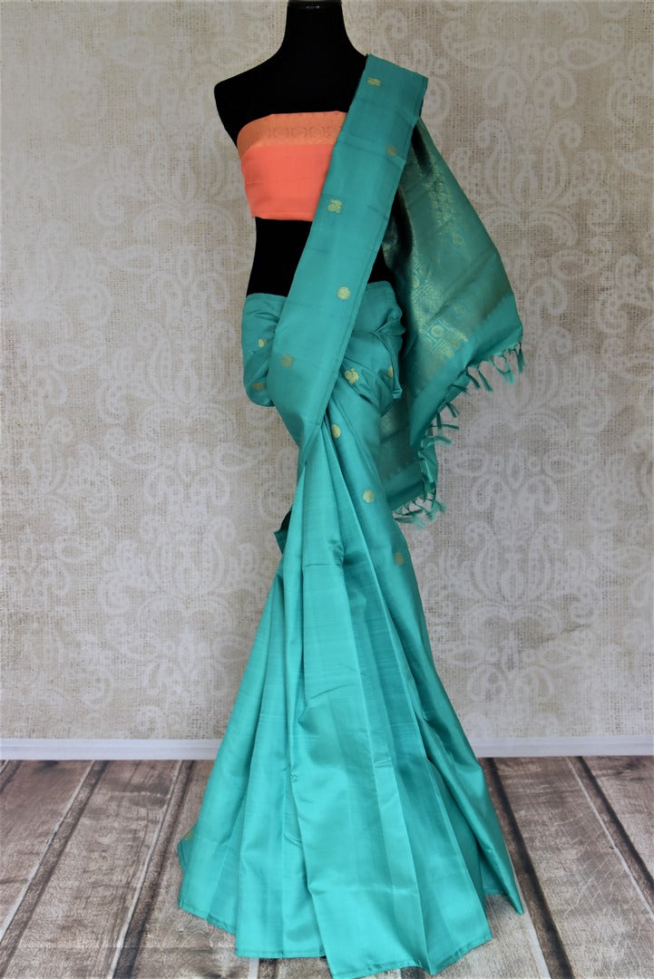 Shop lovely blue borderless Kanjivaram saree online in USA with small peacock and floral zari buta. Give yourself a beautiful traditional makeover this wedding season with exquisite Kanchipuram silk sarees from Pure Elegance Indian fashion boutique in USA.-full view