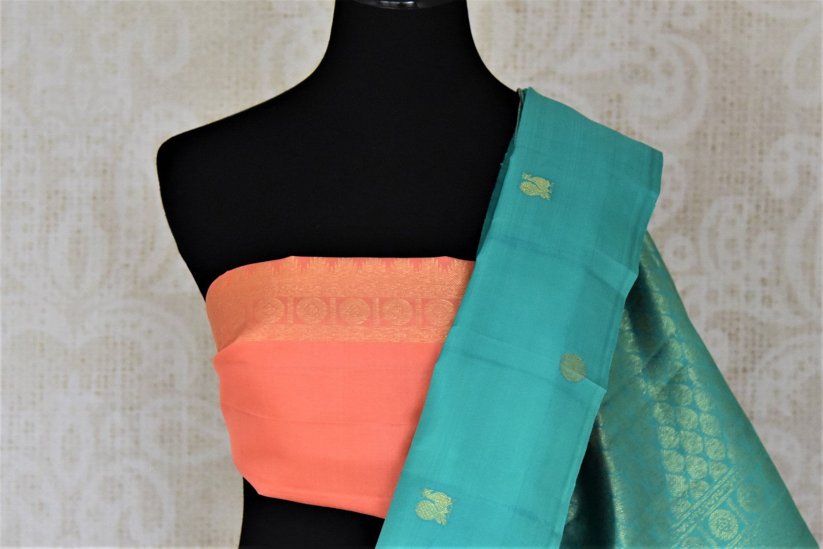 Shop lovely blue borderless Kanjivaram saree online in USA with small peacock and floral zari buta. Give yourself a beautiful traditional makeover this wedding season with exquisite Kanchipuram silk sarees from Pure Elegance Indian fashion boutique in USA.-blouse pallu