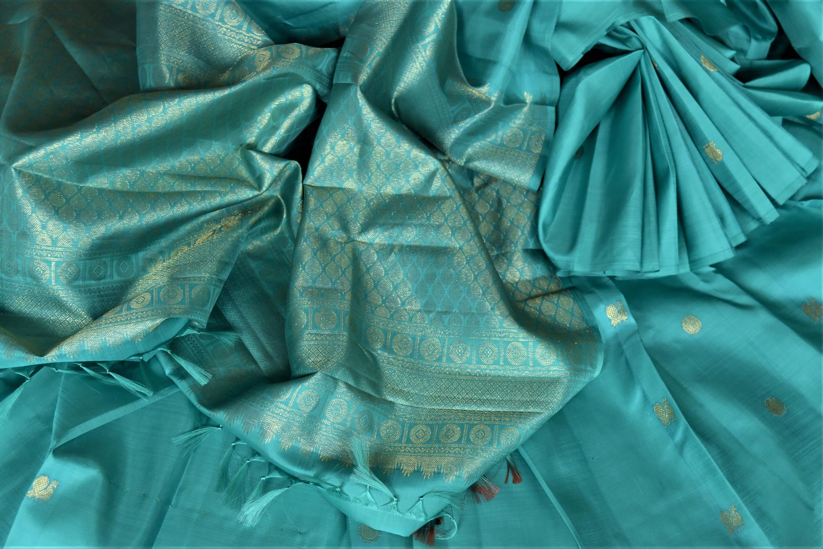 Shop lovely blue borderless Kanjivaram saree online in USA with small peacock and floral zari buta. Give yourself a beautiful traditional makeover this wedding season with exquisite Kanchipuram silk sarees from Pure Elegance Indian fashion boutique in USA.-details