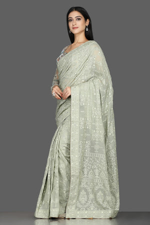 Buy gorgeous tea green Lucknowi georgette saree online in USA with embroidered blouse. Shine at weddings and special occasions with beautiful embroidered sarees, designer sari with blouse in USA from Pure Elegance Indian clothing in USA.-side