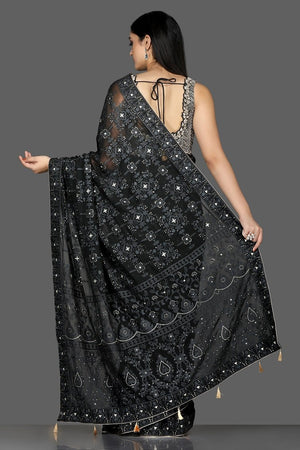 Buy black Lucknowi georgette saree online in USA with embroidered sari blouse. Shine at weddings and special occasions with beautiful embroidered sarees, designer sari with blouse in USA from Pure Elegance Indian clothing in USA.-back