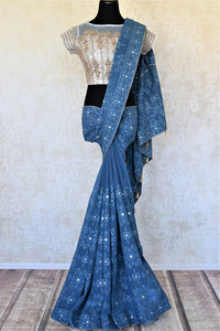Buy gorgeous blue Lucknowi embroidery georgette saree online in USA with embroidered saree blouse. Look fashionable at parties and special occasions in contemporary sarees, designer sarees with blouse, embroidered saris from Pure Elegance Indian luxury clothing store in USA.-full view