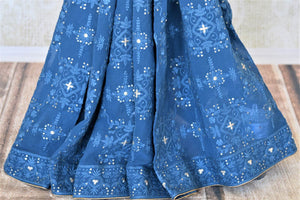 Buy gorgeous blue Lucknowi embroidery georgette saree online in USA with embroidered saree blouse. Look fashionable at parties and special occasions in contemporary sarees, designer sarees with blouse, embroidered saris from Pure Elegance Indian luxury clothing store in USA.-pleats