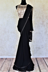 Buy black georgette saree online in USA with hand work net saree blouse. Look like a Bollywood diva with designer sarees, embroidered sarees, Bollywood sarees from Pure Elegance Indian fashion store in USA.-full view