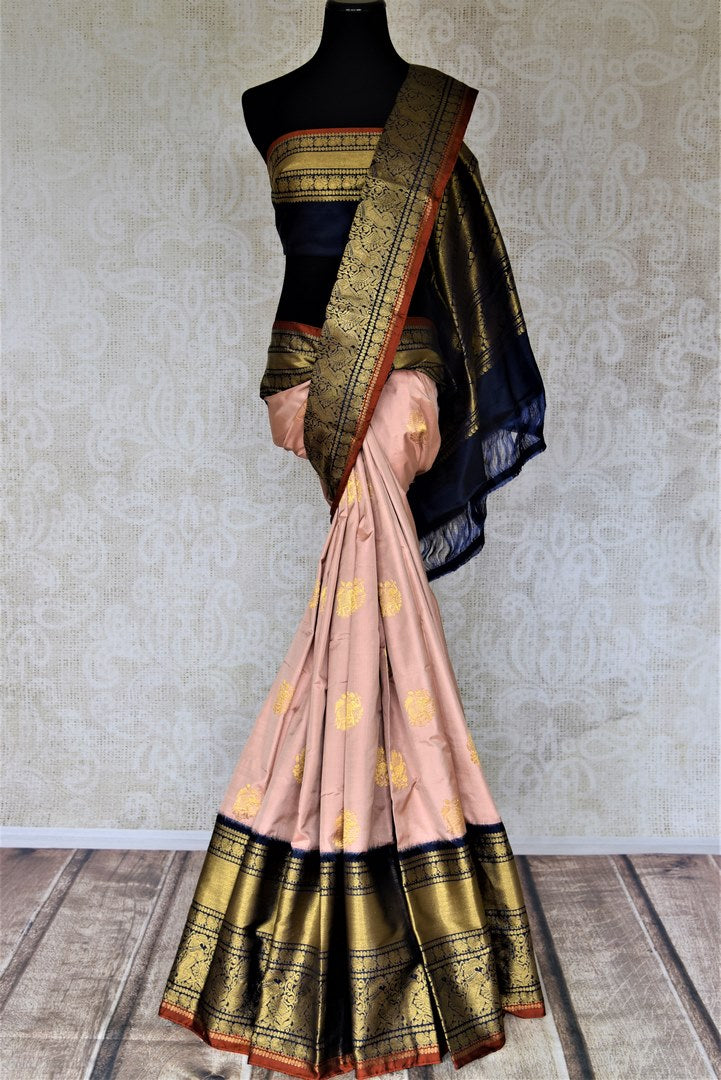 Buy exquisite dusty pink Kanjivaram saree online in USA with heavy golden zari border. Be the center of attraction at parties and weddings with beautiful Kanchipuram silk sarees, pure silk sarees, handwoven sarees, Banarasi sarees from Pure Elegance Indian fashion store in USA.-full view