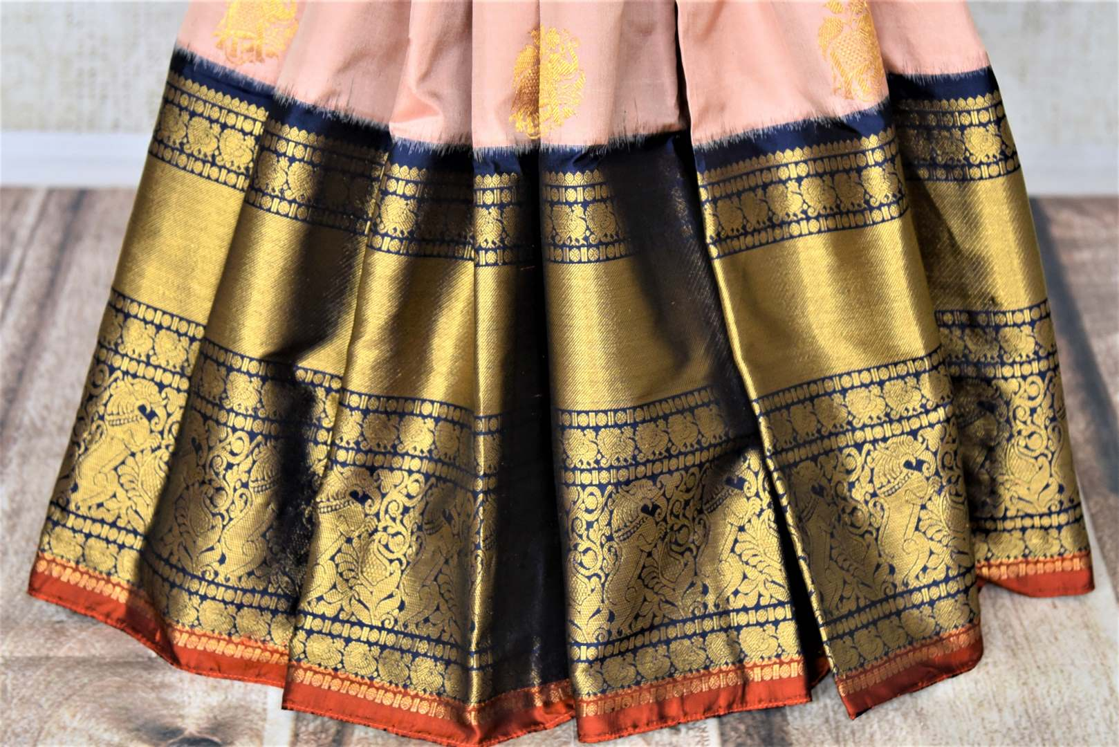 Buy exquisite dusty pink Kanjivaram saree online in USA with heavy golden zari border. Be the center of attraction at parties and weddings with beautiful Kanchipuram silk sarees, pure silk sarees, handwoven sarees, Banarasi sarees from Pure Elegance Indian fashion store in USA.-pleats