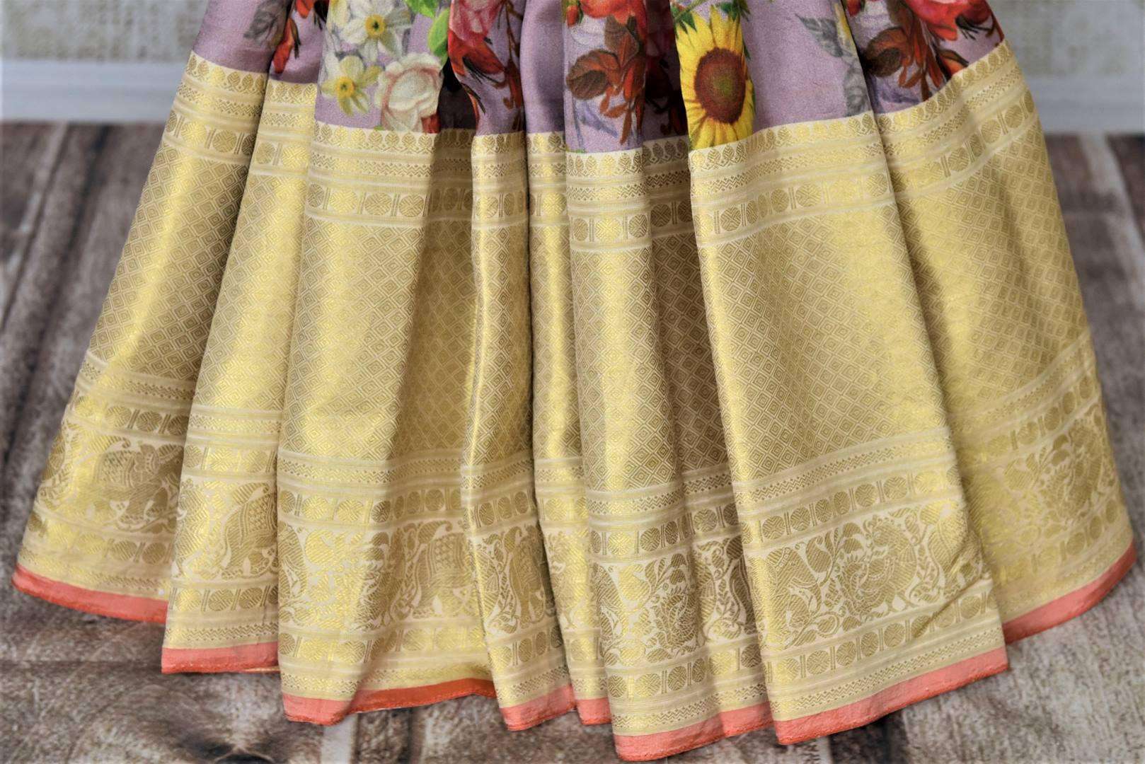 Shop beautiful lilac floral print Kanjivaram saree online in USA with golden zari border. Be the center of attraction at parties and weddings with beautiful Kanchipuram silk sarees, pure silk sarees, handwoven sarees, Banarasi sarees from Pure Elegance Indian fashion store in USA.-pleats
