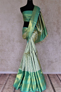 Buy beautiful pastel green Kanjivraram saree online in USA with zari border. Look rich and traditional at weddings and festive occasions with exquisite Kanchipuram silk sarees from Pure Elegance Indian fashion store in USA.-full view