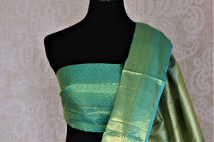 Buy beautiful pastel green Kanjivraram saree online in USA with zari border. Look rich and traditional at weddings and festive occasions with exquisite Kanchipuram silk sarees from Pure Elegance Indian fashion store in USA.-blouse pallu