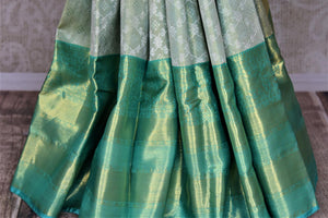 Buy beautiful pastel green Kanjivraram saree online in USA with zari border. Look rich and traditional at weddings and festive occasions with exquisite Kanchipuram silk sarees from Pure Elegance Indian fashion store in USA.-pleats