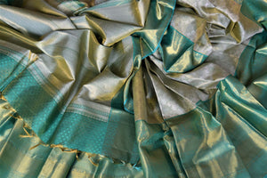 Buy beautiful pastel green Kanjivraram saree online in USA with zari border. Look rich and traditional at weddings and festive occasions with exquisite Kanchipuram silk sarees from Pure Elegance Indian fashion store in USA.-details