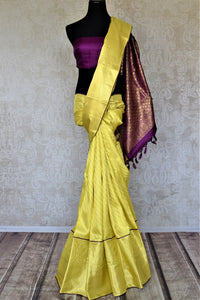 Shop beautiful yellow Kanchipuram silk saree online in USA with golden zari purple pallu. Look fashionable at parties and special occasions in Kanchipuram silk sarees, designer sarees with blouse, embroidered saris from Pure Elegance Indian luxury clothing store in USA.-full view