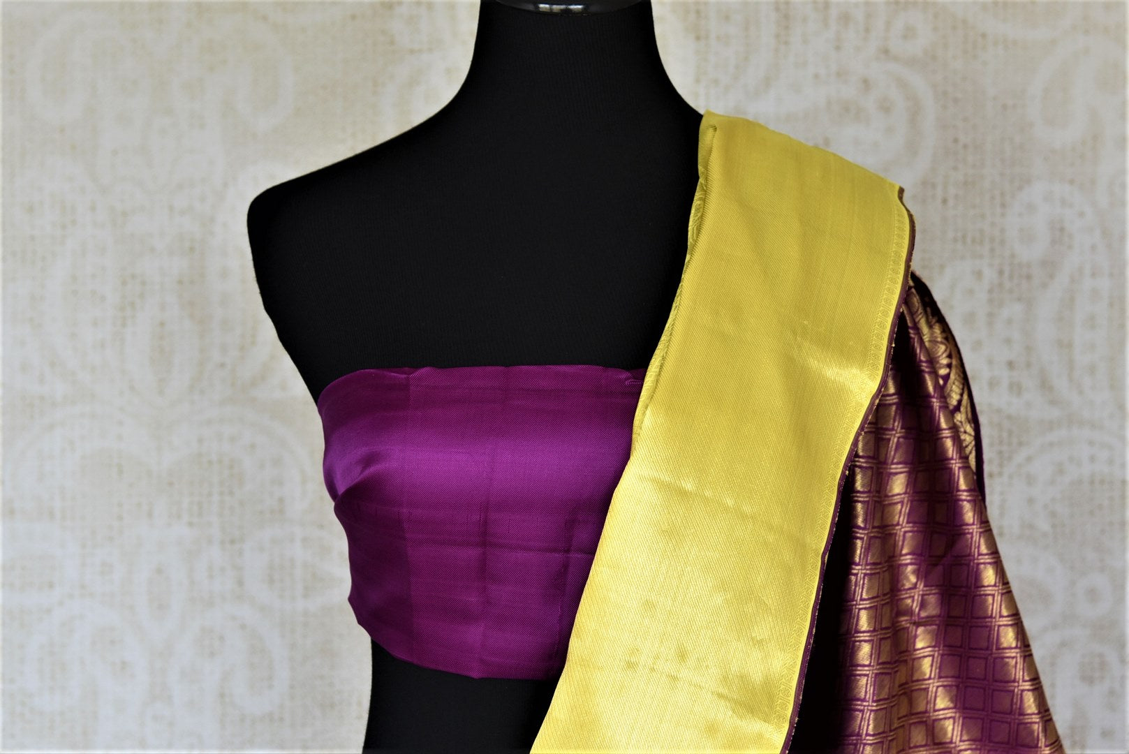 Shop beautiful yellow Kanchipuram silk saree online in USA with golden zari purple pallu. Look fashionable at parties and special occasions in Kanchipuram silk sarees, designer sarees with blouse, embroidered saris from Pure Elegance Indian luxury clothing store in USA.-blouse pallu