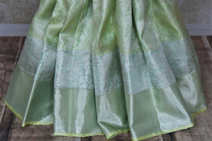 Buy beautiful pastel green silver zari work Kanchipuram saree online in USA. Make a beautiful appearance on special occasions with exquisite Indian designer sarees, Kanchipuram silk saris, Bollywood sarees from Pure Elegance Indian fashion store in USA.-pleats