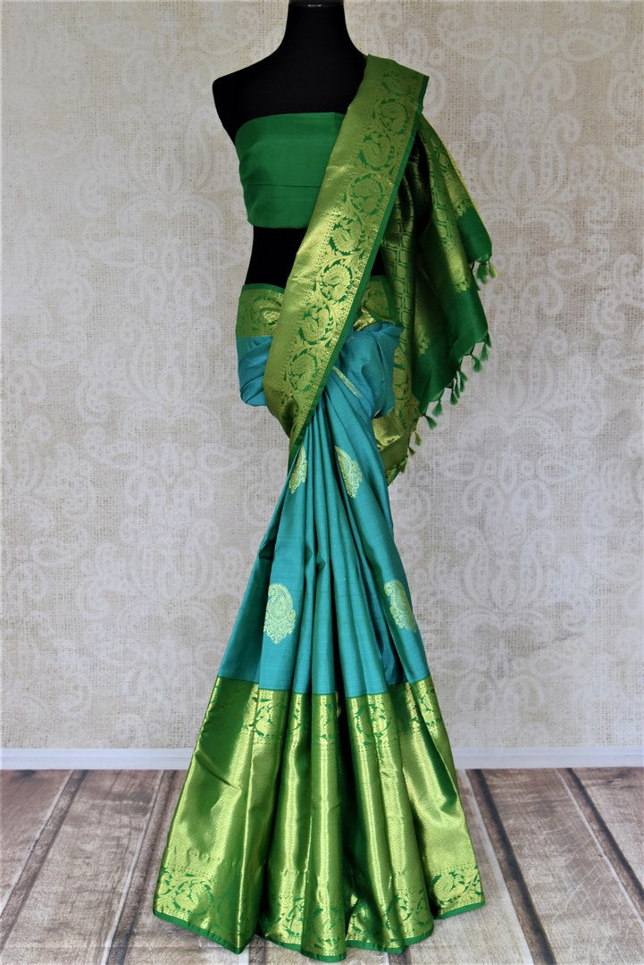 Buy gorgeous blue Kanchipuram saree online in USA with heavy green zari border. Spread your ethnic charm on special occasions with traditional Kanchipuram sarees, soft silk sarees from Pure Elegance Indian fashion store in USA.-full view