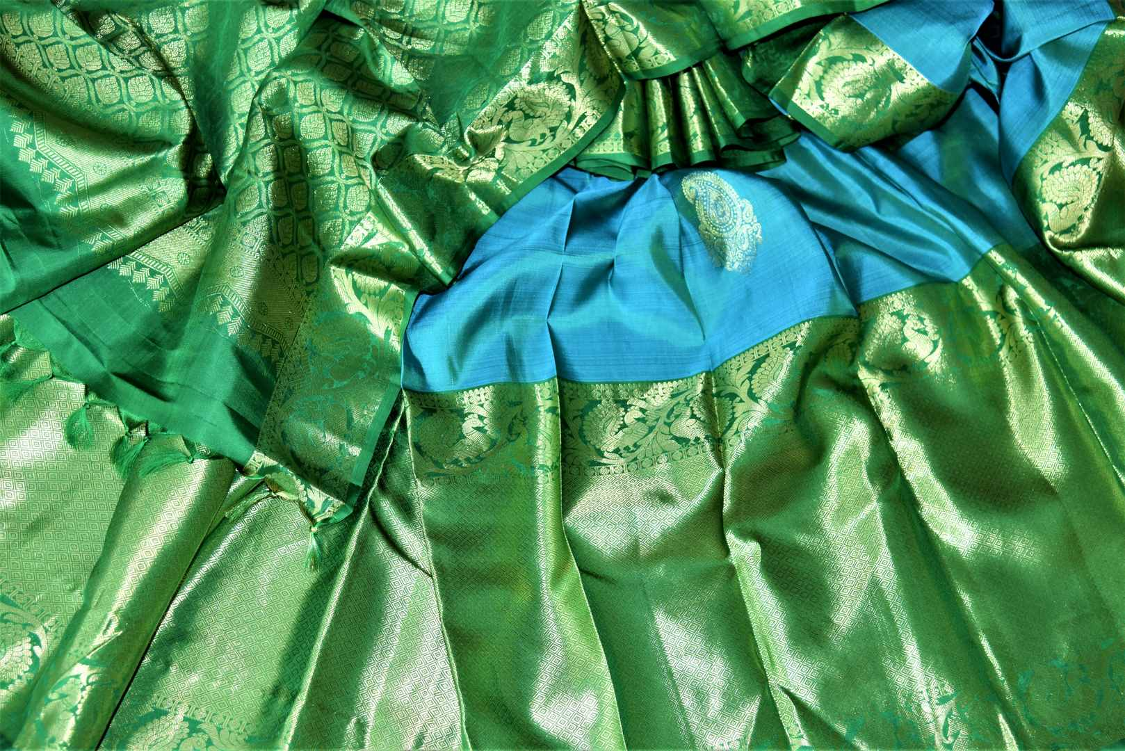 Buy gorgeous blue Kanchipuram saree online in USA with heavy green zari border. Spread your ethnic charm on special occasions with traditional Kanchipuram sarees, soft silk sarees from Pure Elegance Indian fashion store in USA.-details