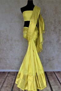 Buy lovely lemon yellow Kanjivaram saree online in USA with golden zari buta and zari border. Look rich and traditional at weddings and festive occasions with exquisite Kanchipuram silk sarees from Pure Elegance Indian fashion store in USA.-full view