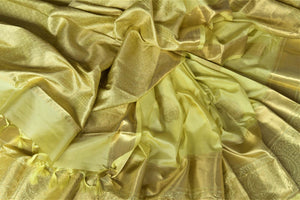 Buy lovely lemon yellow Kanjivaram saree online in USA with golden zari buta and zari border. Look rich and traditional at weddings and festive occasions with exquisite Kanchipuram silk sarees from Pure Elegance Indian fashion store in USA.-details