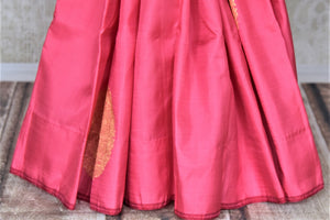 Buy beautiful pink borderless Kanjivaram saree online in USA with heavy zari buta. Spread your ethnic charm on special occasions with traditional Kanchipuram sarees, soft silk sarees from Pure Elegance Indian fashion store in USA.-pleats