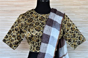 Shop stylish white and brown check linen sari online in USA with Ajrakh saree blouse. Go for a distinct and tasteful saree style on special occasions with handwoven sarees, linen sarees with blouse from Pure Elegance Indian fashion store in USA.-blouse pallu