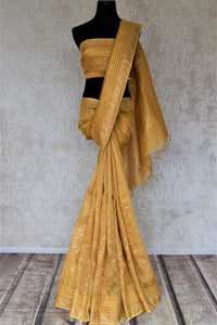 Buy beautiful golden chanderi silk saree online in USA with mirror work and zari border. Keep it light yet festive on special occasions with beautiful chanderi silk sarees from Pure Elegance Indian fashion store in USA.-full view