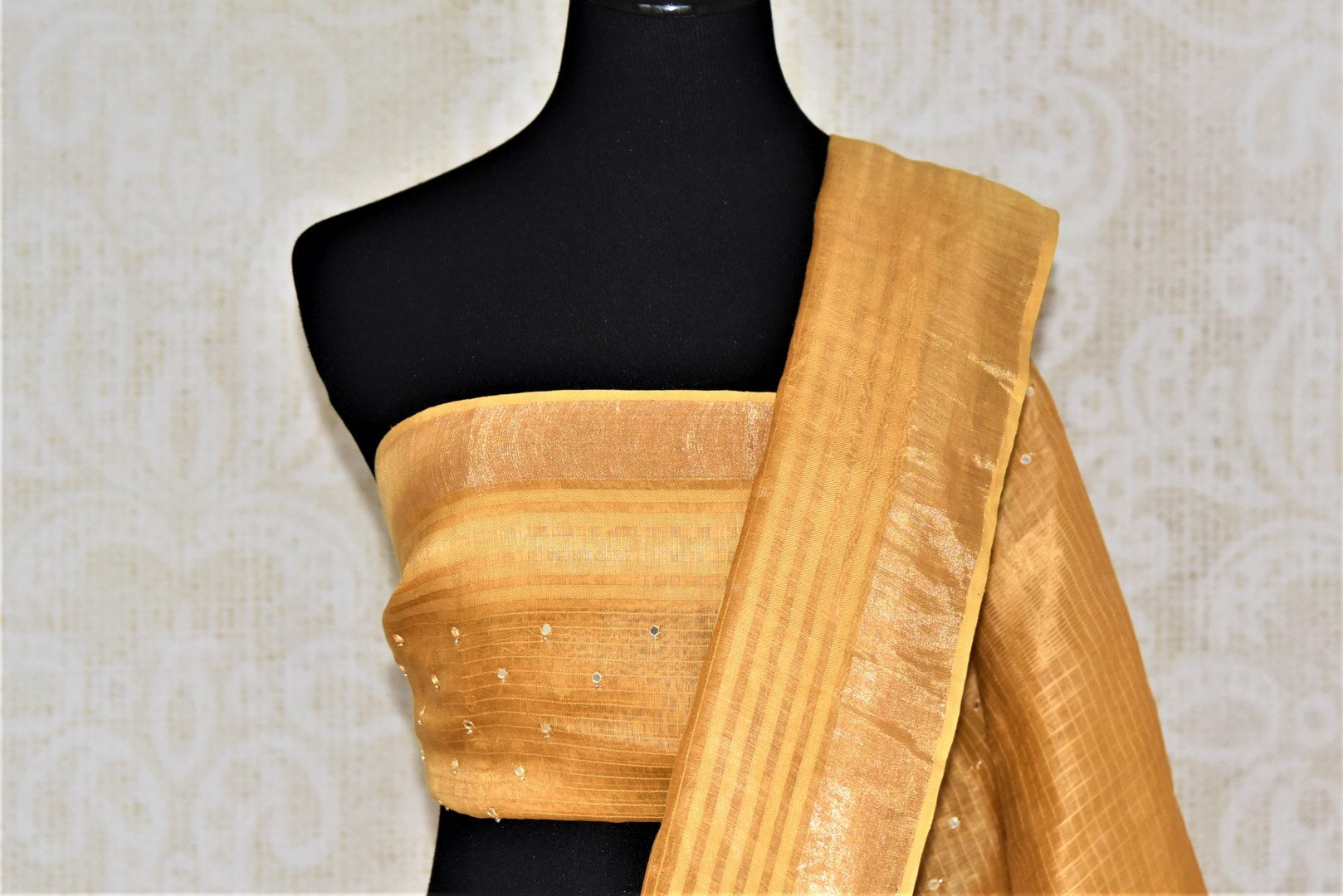 Buy beautiful golden chanderi silk saree online in USA with mirror work and zari border. Keep it light yet festive on special occasions with beautiful chanderi silk sarees from Pure Elegance Indian fashion store in USA.-blouse pallu