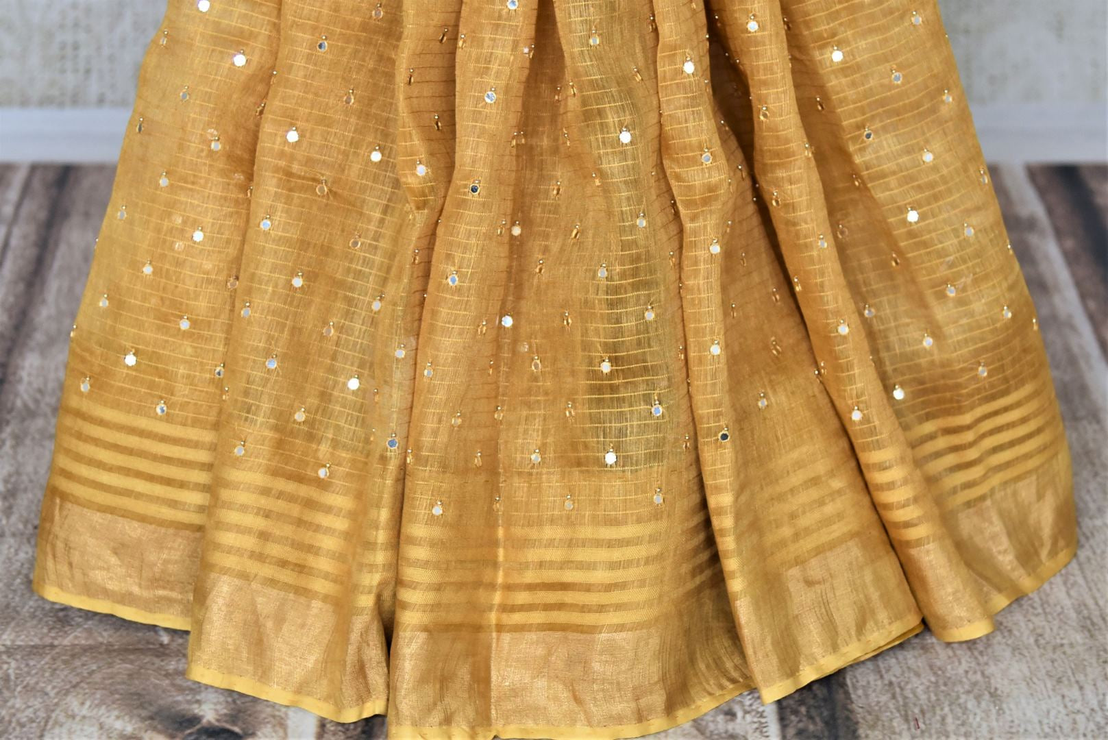 Buy beautiful golden chanderi silk saree online in USA with mirror work and zari border. Keep it light yet festive on special occasions with beautiful chanderi silk sarees from Pure Elegance Indian fashion store in USA.-pleats