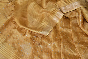 Buy beautiful golden chanderi silk saree online in USA with mirror work and zari border. Keep it light yet festive on special occasions with beautiful chanderi silk sarees from Pure Elegance Indian fashion store in USA.-details