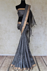 Shop lovely dark grey chanderi silk sari online in USA with mirror work and zari border. Keep it light yet festive on special occasions with beautiful chanderi silk sarees from Pure Elegance Indian fashion store in USA.-full view