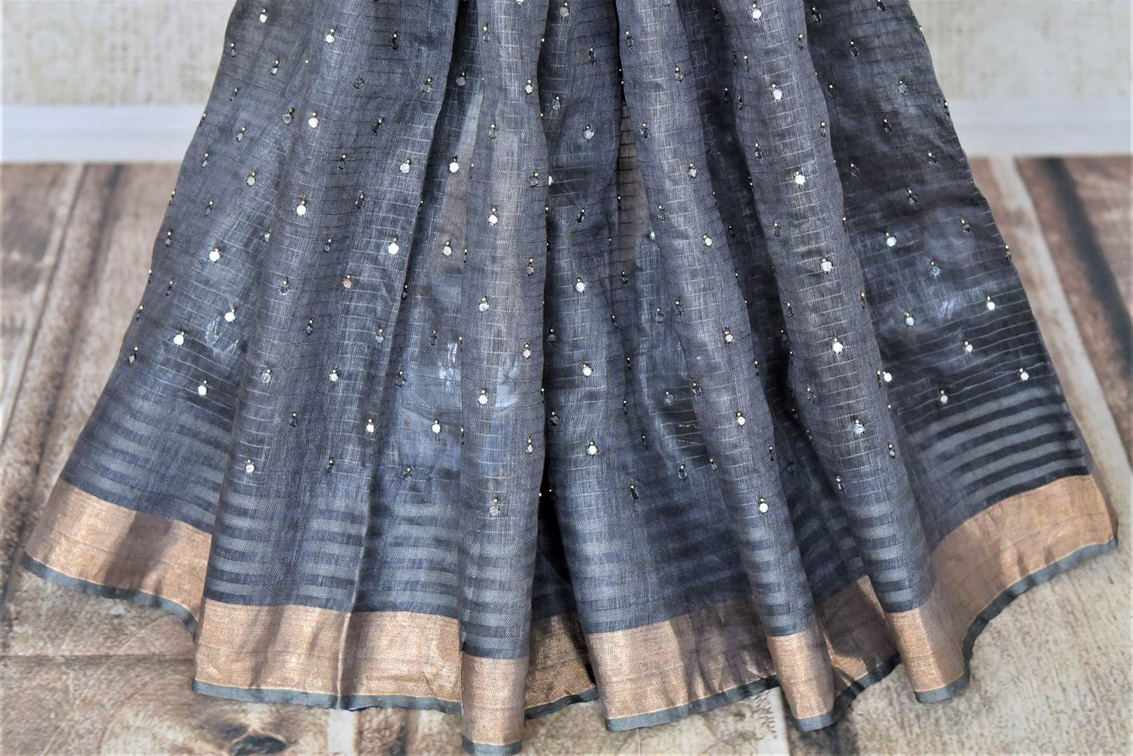 Shop lovely dark grey chanderi silk sari online in USA with mirror work and zari border. Keep it light yet festive on special occasions with beautiful chanderi silk sarees from Pure Elegance Indian fashion store in USA.-pleats