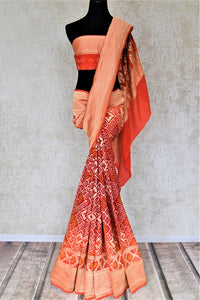 Buy red and orange bandhej georgette Banarasi saree online in USA. Spread your ethnic charm on special occasions with traditional Banarasi sarees, bandhej sarees, georgette sarees from Pure Elegance Indian fashion store in USA.-full view