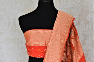 Buy red and orange bandhej georgette Banarasi saree online in USA. Spread your ethnic charm on special occasions with traditional Banarasi sarees, bandhej sarees, georgette sarees from Pure Elegance Indian fashion store in USA.-blouse pallu