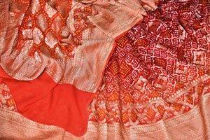 Buy red and orange bandhej georgette Banarasi saree online in USA. Spread your ethnic charm on special occasions with traditional Banarasi sarees, bandhej sarees, georgette sarees from Pure Elegance Indian fashion store in USA.-details