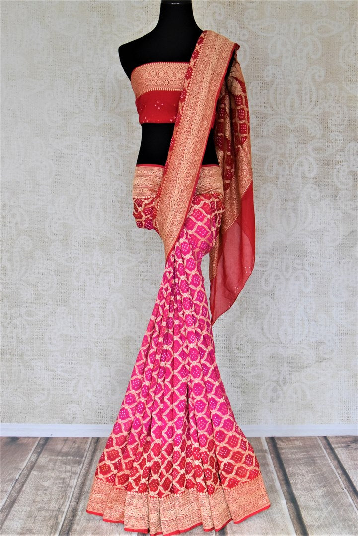 Shop bright pink and red bandhej georgette Banarasi saree online in USA. Spread your ethnic charm on special occasions with traditional Banarasi sarees, bandhej sarees, georgette sarees from Pure Elegance Indian fashion store in USA.-full view