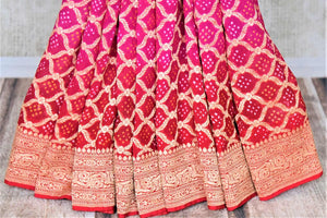 Shop bright pink and red bandhej georgette Banarasi saree online in USA. Spread your ethnic charm on special occasions with traditional Banarasi sarees, bandhej sarees, georgette sarees from Pure Elegance Indian fashion store in USA.-pleats