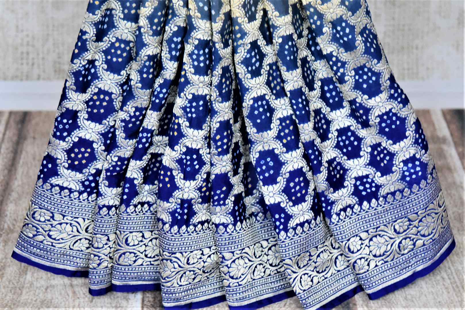 Buy stunning ombre blue bandhej georgette Banarasi sari online in USA. Spread your ethnic charm on special occasions with traditional Banarasi sarees, bandhej sarees, georgette sarees from Pure Elegance Indian fashion store in USA.-pleats