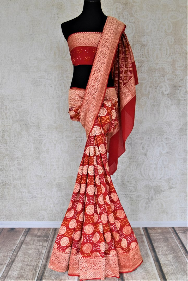 Shop ethnic red georgette Banarasi sari online in USA with bandhej print. Spread your ethnic charm on special occasions with traditional Banarasi sarees, bandhej sarees, georgette sarees from Pure Elegance Indian fashion store in USA.-full view