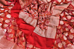 Shop ethnic red georgette Banarasi sari online in USA with bandhej print. Spread your ethnic charm on special occasions with traditional Banarasi sarees, bandhej sarees, georgette sarees from Pure Elegance Indian fashion store in USA.-details