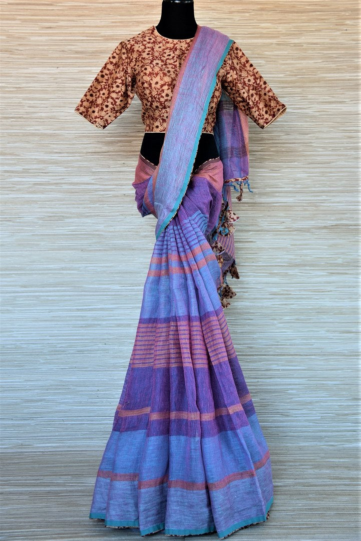 Buy blue and purple striped linen saree online in USA with Ajrakh saree blouse. Go for a distinct and tasteful saree style on special occasions with handwoven sarees, linen sarees with blouse from Pure Elegance Indian fashion store in USA.-full view