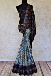 Buy blue Ajrakh gajji silk sari online in USA with bandhej print border. Choose tasteful Indian sarees for special occasions from Pure Elegance. Our exclusive Indian fashion store has a myriad of stunning pure silk sarees, printed sarees, handwoven saris for Indian women in USA.-full view