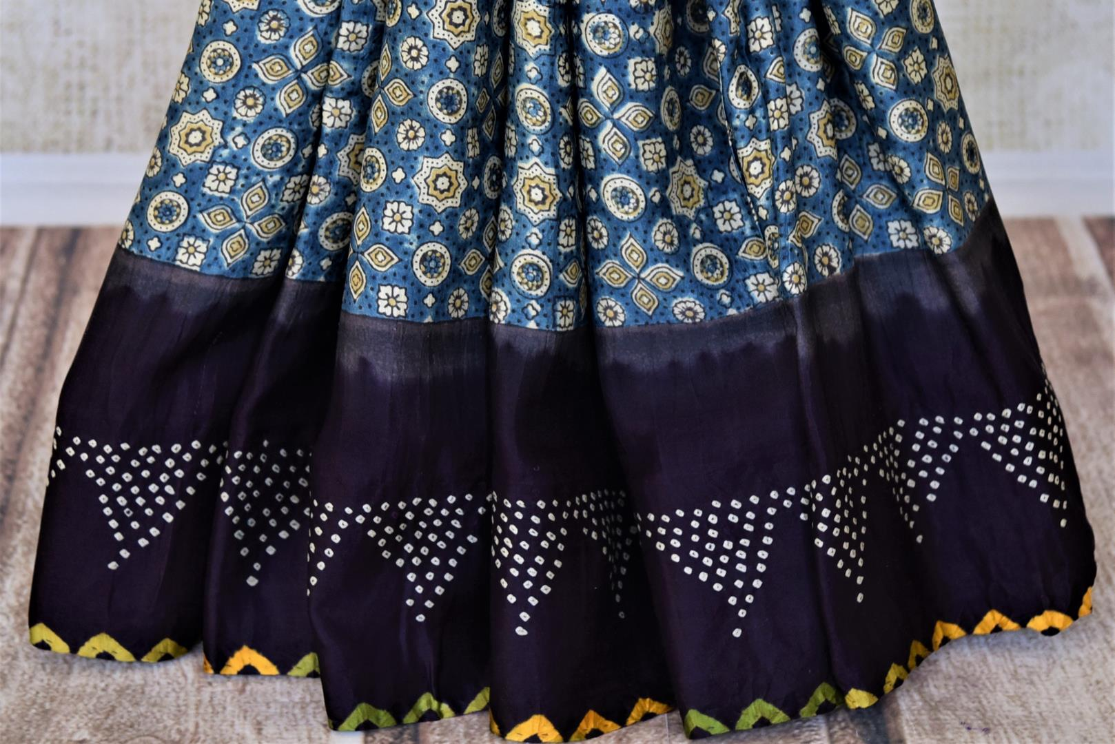 Buy blue Ajrakh gajji silk sari online in USA with bandhej print border. Choose tasteful Indian sarees for special occasions from Pure Elegance. Our exclusive Indian fashion store has a myriad of stunning pure silk sarees, printed sarees, handwoven saris for Indian women in USA.-pleats