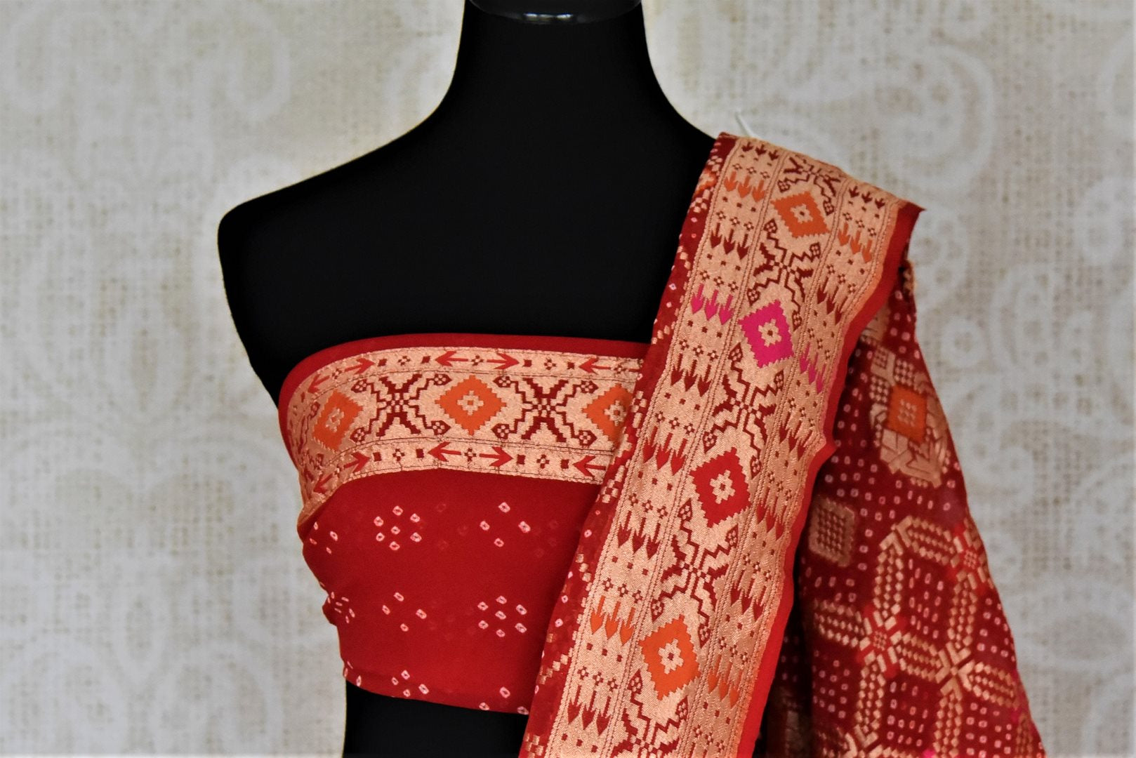 Shop beautiful orange and red georgette Banarasi bandhej sari online in USA. Spread your ethnic charm on special occasions with traditional Banarasi sarees, bandhej sarees, georgette sarees from Pure Elegance Indian fashion store in USA.-blouse pallu