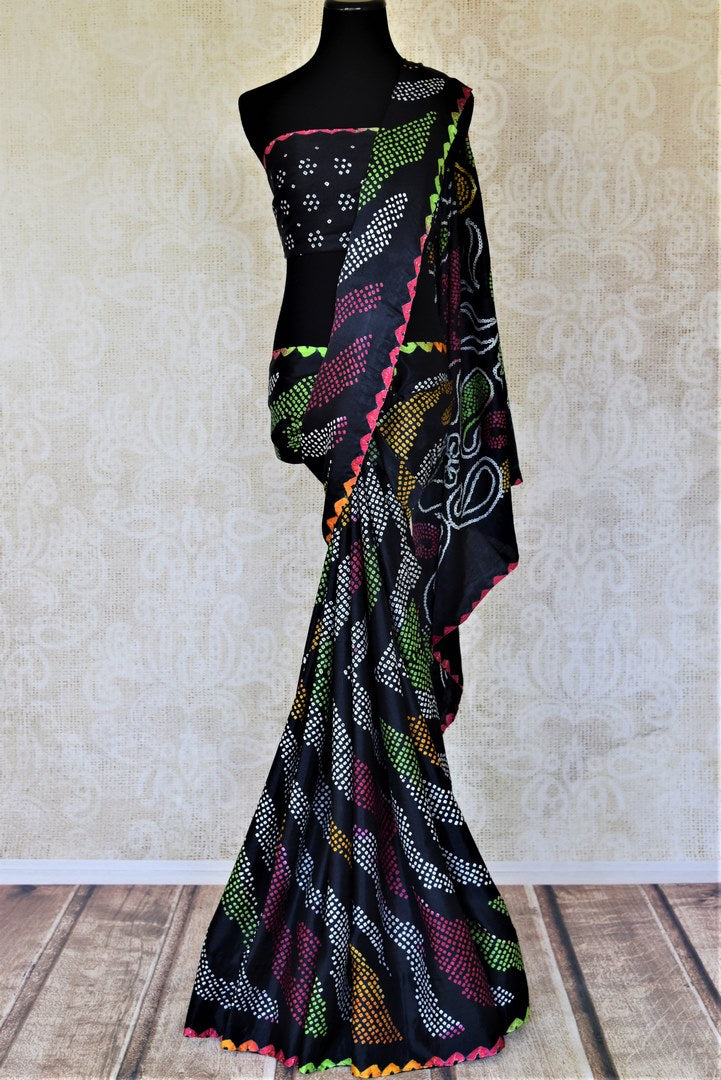 Buy stunning black gajji silk bandhani saree online in USA. Choose tasteful Indian sarees for special occasions from Pure Elegance. Our exclusive Indian fashion store has a myriad of stunning pure silk saris, printed sarees, handwoven saris for Indian women in USA.-full view