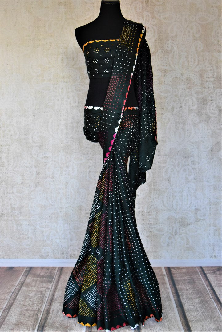 Shop beautiful dark green gajji silk bandhani sari online in USA. Choose tasteful Indian sarees for special occasions from Pure Elegance. Our exclusive Indian fashion store has a myriad of stunning pure silk saris, printed sarees, handwoven saris for Indian women in USA.-full view