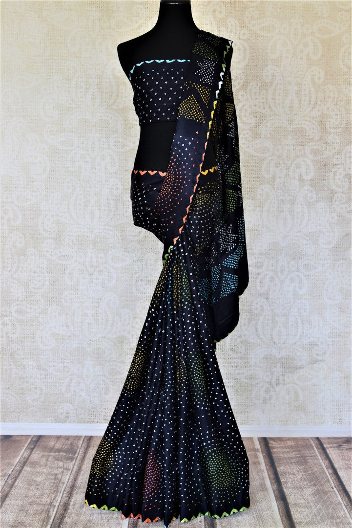 Buy elegant dark blue gajji silk bandhej sari online in USA. Choose tasteful Indian sarees for special occasions from Pure Elegance. Our exclusive Indian fashion store has a myriad of stunning pure silk saris, printed sarees, handwoven saris for Indian women in USA.-full view